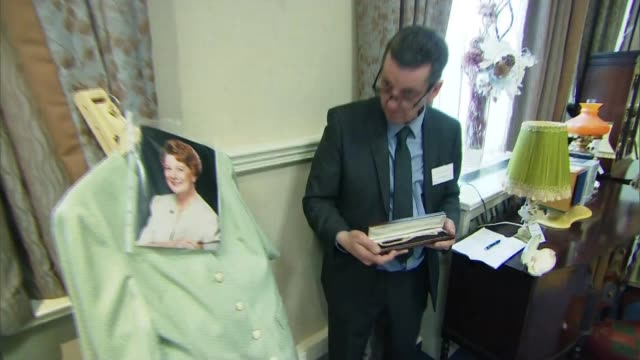 Jean Alexander memorabilia auction ENGLAND Lancashire Southport INT Various of auction of memorabilia associated with former Coronation Street actor...