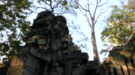 A Temple in Angkor Wat, Cambodia surrounded by trees