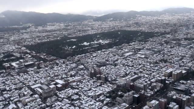 Temples and shrines in Kyoto turned white early Thursday morning as first snowfall in this winter season was recorded in the old capital of Japan in...
