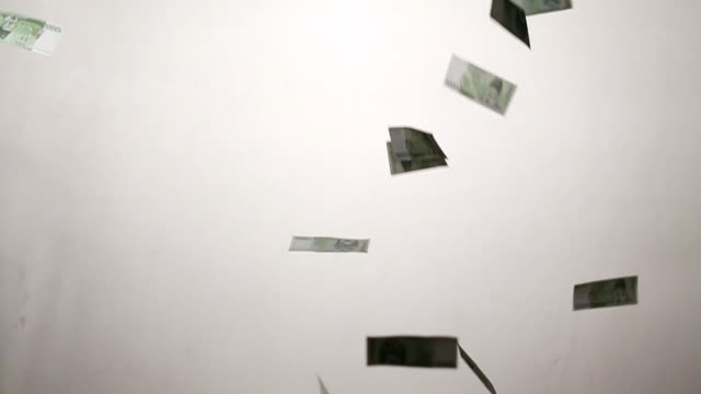 MS Ten thousand Korean won notes falling against white backdrop / Seoul, South Korea