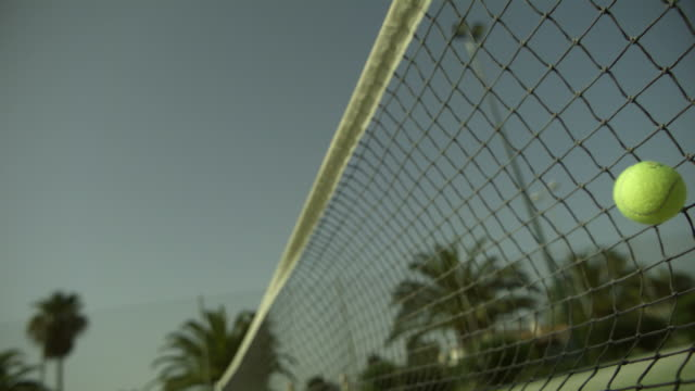 SLO MO tennis ball hits net left to right, Spain