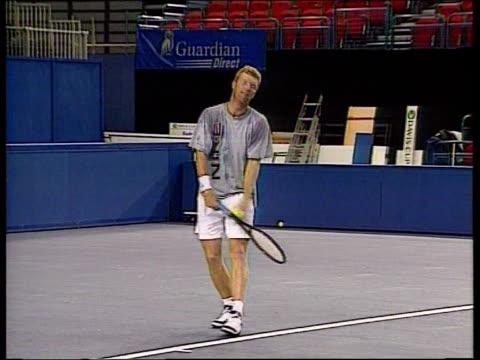 Birmingham Davis Cup ULAY ENGLAND Birmingham Indoor Arena INT Greg Rusedski Tim Henman Jim Courier and Todd Martin warming up on court