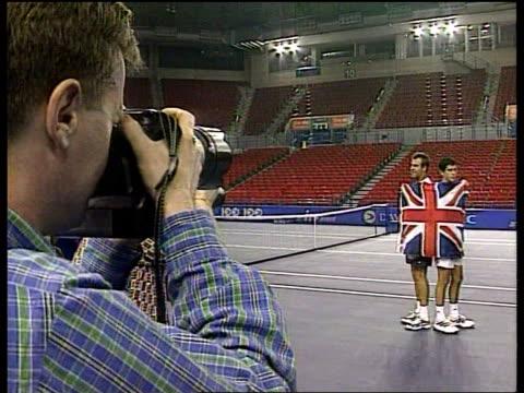 Davis cup ITN ENGLAND Birmingham Indoor Arena Tim Henman practising with Greg Rusedski Henman Rusedski standing for photocall wrapped in Union Jack...