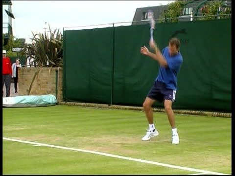 Davis cup relegation playoff ENGLAND London Wimbledon Greg Rusedski towards with others behind arriving for Davis Cup relegation playoff match with...