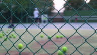 Tennis instructor in action on tennis court
