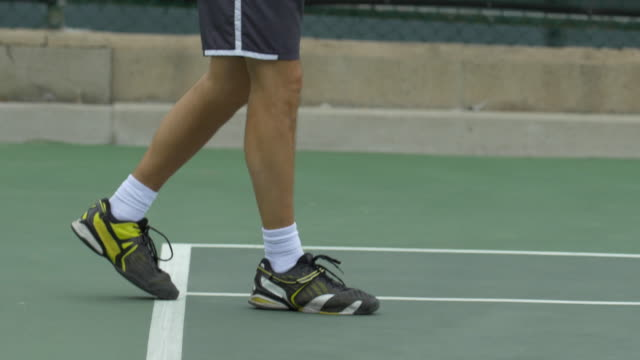 Tennis player practicing his return stance.