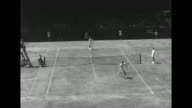WS tennis stadium with crowded stands at the New South Open at White City / LS tennis match in progress between Australia's Mervyn Rose vs America's...