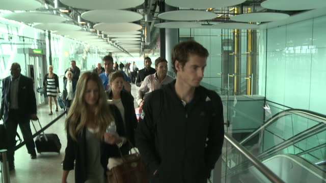 Tennis star Andy Murray flies into Heathrow after his win at the US Open accompanied by fiance Kim Sears Good together shots as they walk though...