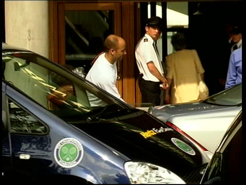 Wimbledon Mens semi finals ITN LMS Andre Agassi out of building to put bag in boot of car
