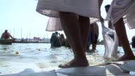Tens of millions of Hindu pilgrims prepare to cleanse their sins with a plunge into the sacred river Ganges at the world's largest religious festival...