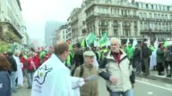 Tens of thousands of Belgians gathered for a huge march through the capital Brussels Thursday in the first mass protest against the new centre right...