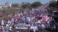 Tens of thousands of female rural workers march in Brasilia in support of women's rights and President Dilma Rousseff