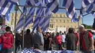 Tens of thousands of Greeks poured into the streets on Tuesday as mass strikes paralysed Athens in the latest show of anger over a new government...