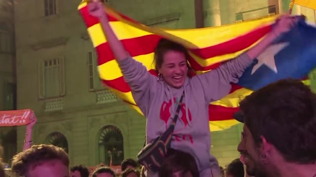 Tens of thousands of independence supporters massed near the Catalan parliament cheered with joy Friday after majority separatist lawmakers voted to...
