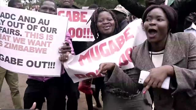Tens of thousands of overjoyed protesters flooded Zimbabwe's streets Saturday celebrating President Robert Mugabe's slipping power on the eve of...