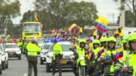 Tens of thousands of people mobbed the streets of Bogota to grab a glimpse of their heroes as Colombias World Cup squad arrived home Sunday after...