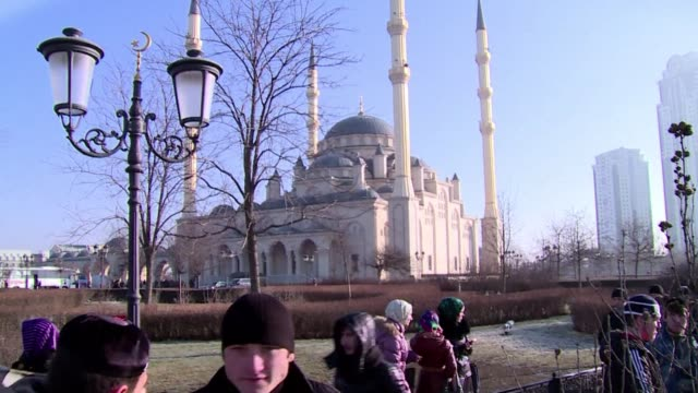 Tens of thousands of people rallied Monday at a state sponsored protest in Russia's Muslim North Caucasus region of Chechnya against the publication...