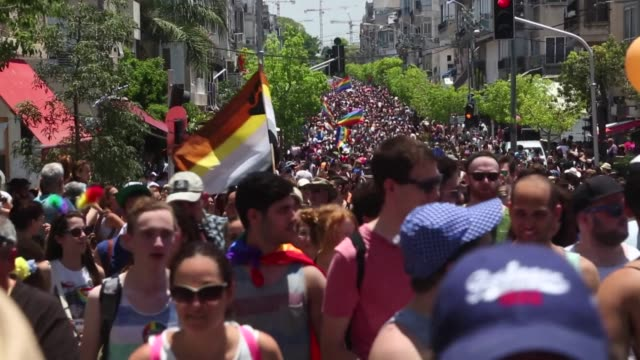 Tens of thousands of people turned out on Friday for Israel's annual gay pride parade dancing in the streets of Tel Aviv and waving rainbowcoloured...