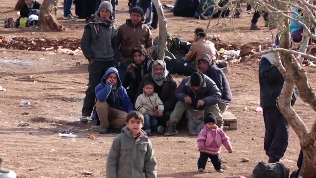 Tens of thousands of Syrians were apparently streaming towards Turkey on Friday as regime troops pressed a major Russianbacked offensive around...