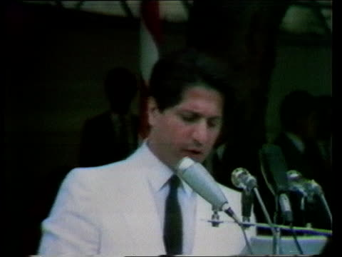 Tension in Lebanon grows ITN LIB MS Lebanese President Amin Gemayel delivering speech MS Lebanese army recruits march towards PULL BACK as LR