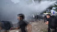 Tensions at Hungary's border with Serbia reached boiling point as refugees and their families were sprayed with tear gas pepper spray and water...