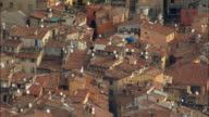 AERIAL Terracotta rooftops with satellite dishes/ Grasse, France