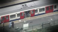 Terror attacks putting increased strain on police force LIB / 1592017 London Parsons Green Police officers on platform next to Tube train AIR VIEW...