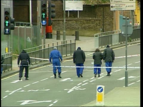 Hendon sorting office second bomb attack ITN ENGLAND London Police officers searching for clues after second bomb attack on Royal Mail sorting office...