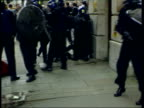 New laws come into force LIB BV Police in riot gear restraining screaming protestor BV Riot police dragging protestor along