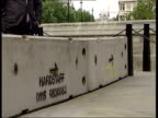Terrorist threat concrete blocks outside parliament ITN London Westminster EXT MS Line of concrete blocks outside Houses of Parliament TILT UP Vox...