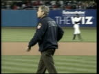 New warning POOL USA New York Yankee Stadium President George W Bush wearing New York Fire Department sweatshirt walking out to deliver opening pitch...