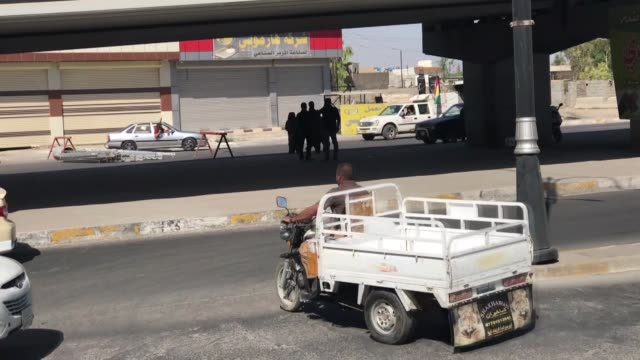 PKK terrorists with their guns are seen at the streets of of Kirkuk Iraq on October 16 2017 Iraqi forces on Monday seized full control of the...