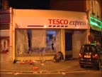Tesco in Ealing Broadway with smashed windows after looting has taken place August 2011