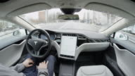 CLOSE UP: Tesla Model S self-driving autopilot autosteering in urban city