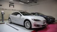 Tesla Motors Inc Model S 90D electric vehicles are parked at the company's charging station in the Starfield Hanam shopping complex operated by...