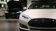 A Tesla Motors Inc Model S electric vehicle stands on display near the entrance of the company's showroom in Beijing China on Tuesday Nov 11 Tesla...