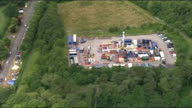 Test drilling begins at West Sussex fracking site Aerial shots of site and protesters ENGLAND West Sussex Balcombe fracking site / Close up...