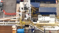 Test drilling begins at West Sussex fracking site Aerial shots of site and protesters Close up fracking site / Fracking machine / Demonstrators and...