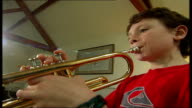 Testing of gene therapy treatment for cystic fibrosis announced ENGLAND London Ollie Keyzor playing the trumpet SOT