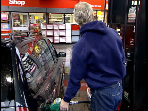 Newcastle EXT GVS drivers filling cars at Texaco petrol station / man filling plastic containers in van / undertaker filling hearse / GVS forecourt
