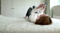 Texting laying on bed       LI CM