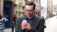 Texting, urban man.