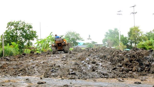 thai man drive tractor forward