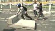 Thai police allow opposition protesters through barricades outside the government and metropolitan police headquarters sharply easing tensions after...
