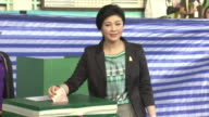 Thailand Prime Minister Yingluck Shinawatra casts her vote as polls open on election day Feb 2nd 2014