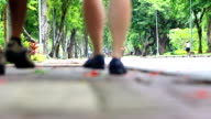 Thailand Video. Couple walking in City Park Lumphini Bangkok
