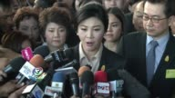 Thailand's ousted prime minister Yingluck Shinawatra arrives for the start of a criminal negligence trial that could see her jailed for a decade