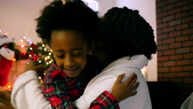 Thankful African American Girl Hugging Mom on Christmas Morning