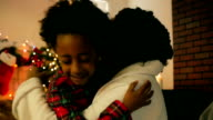 Thankful African-American Little Girl Hugging Mom on Christmas Morning