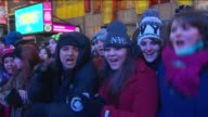 The 2014 New Year's Eve Ball Drop Crowds Cheer at Times Square New Years Eve Drop at One Times Square on January 01 2014 in New York New York